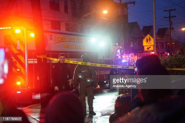 Security officers take security measures after multiple people including a police officer have been killed in a shootout in the US state of New...