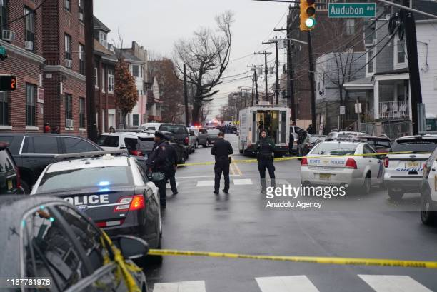 Security officers take security measures after USpolice officers were shot in the US state of New Jersey at a cemetery on December 10 2019