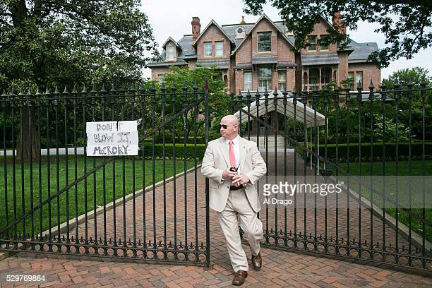 STATES MAY 9 A security official arrives to take down a sign taped to the gate outside of the Governor's Mansion in Raleigh NC on Monday May 9 2016...