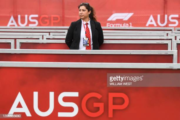 Security official looks on after the cancellation of the Australian Grand Prix in Melbourne on March 13, 2020. - The season-opening Australian Grand...