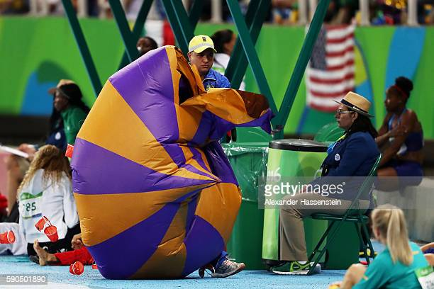 A security official removes an object from the field of play on Day 11 of the Rio 2016 Olympic Games at the Olympic Stadium on August 16 2016 in Rio...