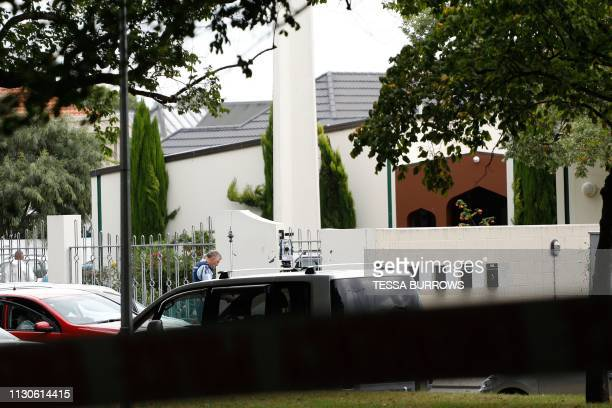 A security official stands guard outside the Masjid al Noor mosque after a shooting incident in Christchurch on March 15 2019 Attacks on two...