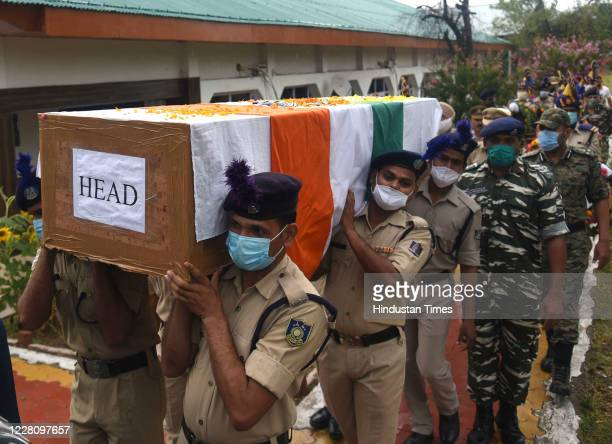 Security officials carry the coffins of the martyred soldiers for the wreathlaying ceremony on August 18 2020 on the outskirts of Srinagar India At...
