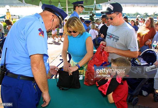 Security officials checks bags as people enter Walt Disney World's Magic Kingdom November 11 2001 in Orlando Florida