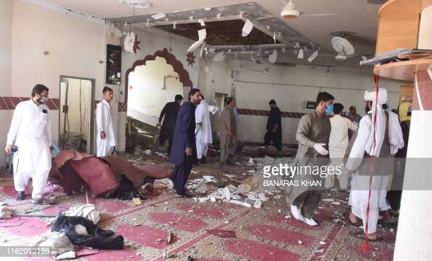 TOPSHOT Security officials examine the blast site at a mosque in the town of Kuchlak in southwest Quetta on August 16 2019 At least two people were...
