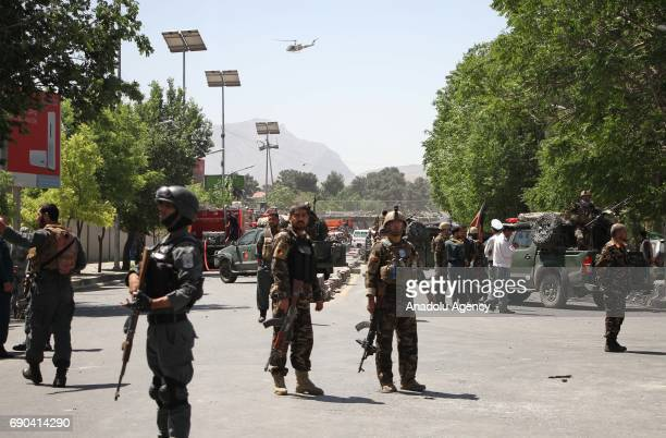 NATO security officials inspect the site of a powerful suicide attack in Kabul Afghanistan on May 31 2017 At least 80 people were killed and over 350...