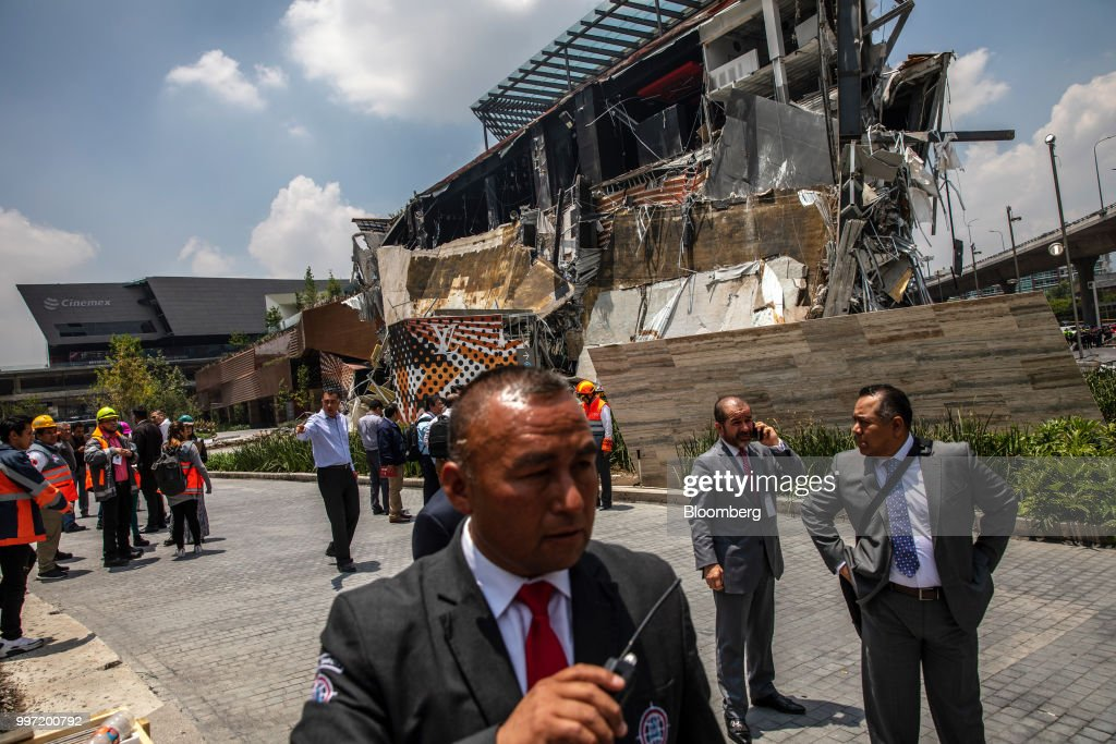 Security officials stand in front of the collapsed section of the Artz Pedregal shopping mall in Mexico City, Mexico, on Thursday, July 12, 2018. A section of the high-end fashionmallinaugurated a mere three months ago collapsed Thursday afternoon in Mexico City. Photographer: Alejandro Cegarra/Bloomberg via Getty Images