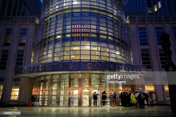 Security officials stand in the lobby of the United States District Court for the Eastern District of New York on the first day of the trial for...