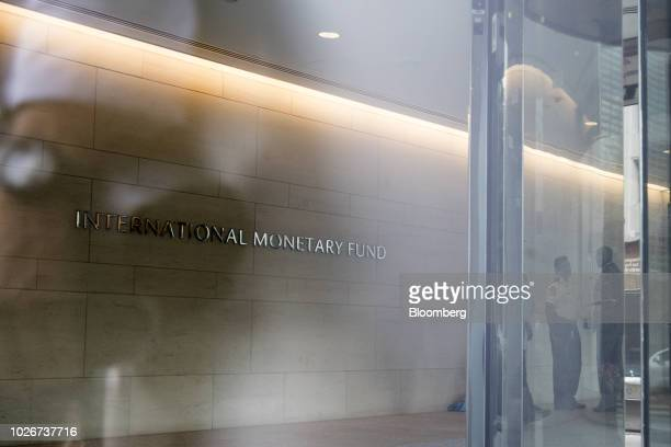 Security officials stand inside the International Monetary Fund headquarters in Washington DC US on Tuesday Sept 4 2018 Argentine officials will meet...