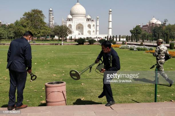 Security officials use metal detectors at the Taj Mahal in Agra on March 4, 2021 following the evacuation of tourists after a bomb threat.