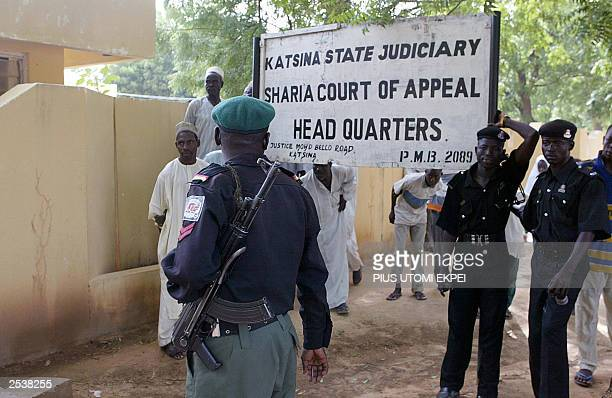 Security operatives keep alert at the main entrance of the Katsina State Sharia Court of Appeal 25 September 2003 in Katsina as Amina Lawal's appeal...