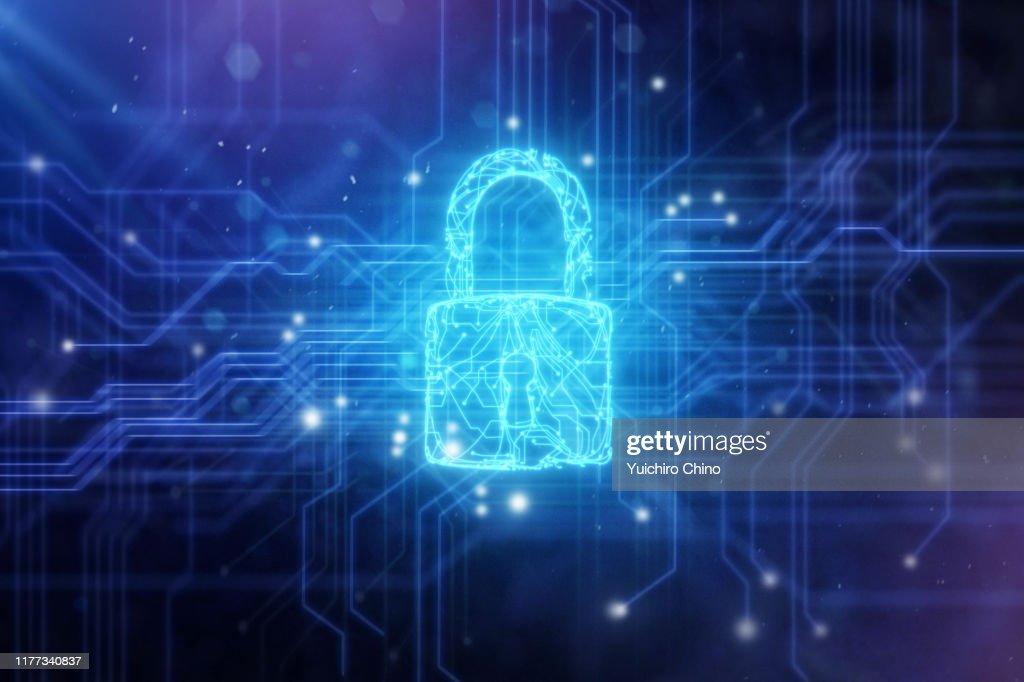 Security padlock in circuit board : Stock Photo