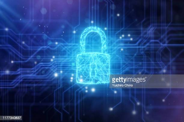 security padlock in circuit board - security stock pictures, royalty-free photos & images