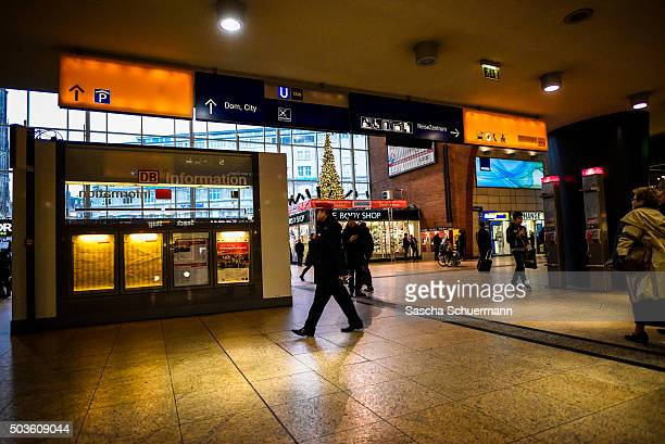 Security patrol as pedestrians enter the Hauptbahnhof main railway station on January 6 2015 in Cologne Germany 90 women have filed charges with...