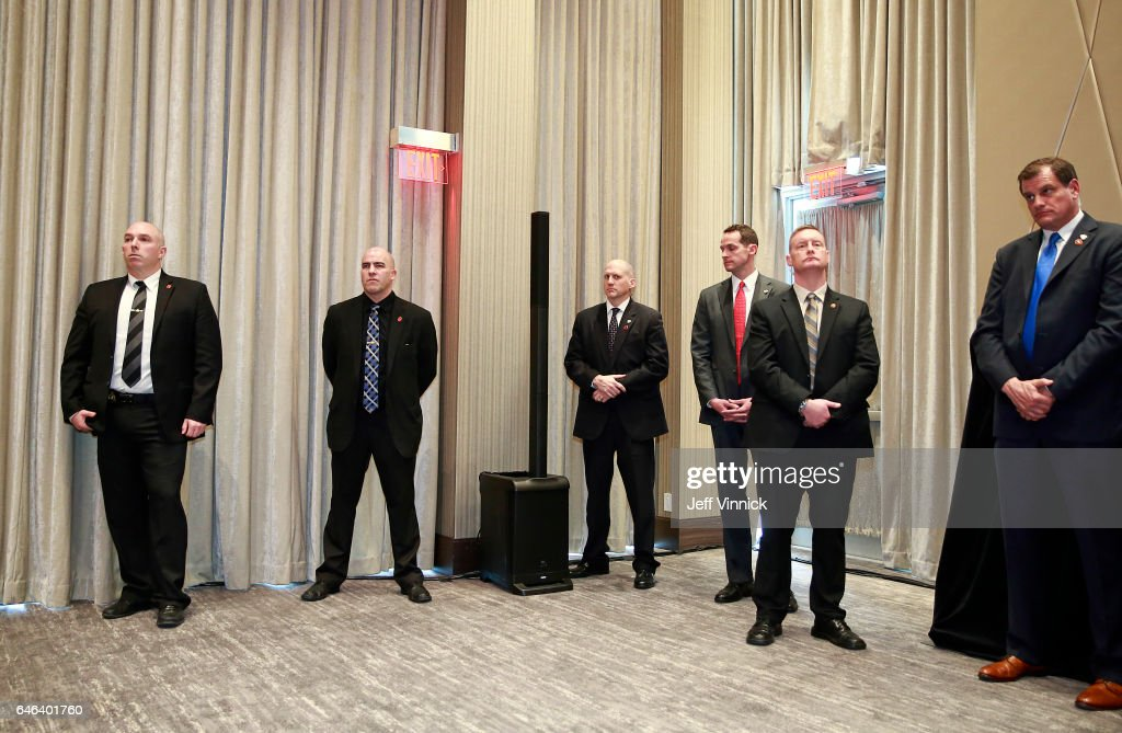 Security personal look on during the ceremony for the official opening of the Trump International Tower and Hotel on February 28, 2017 in Vancouver, Canada. The tower is the Trump Organization's first new international property since Donald Trump assumed the presidency.