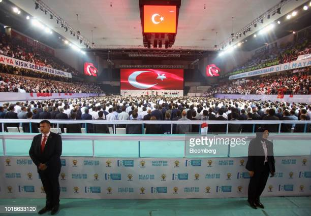 A supporter holds a large banner depicting Recep Tayyip Erdogan Turkey's president during the Justice and Development Party congress in Ankara Turkey...