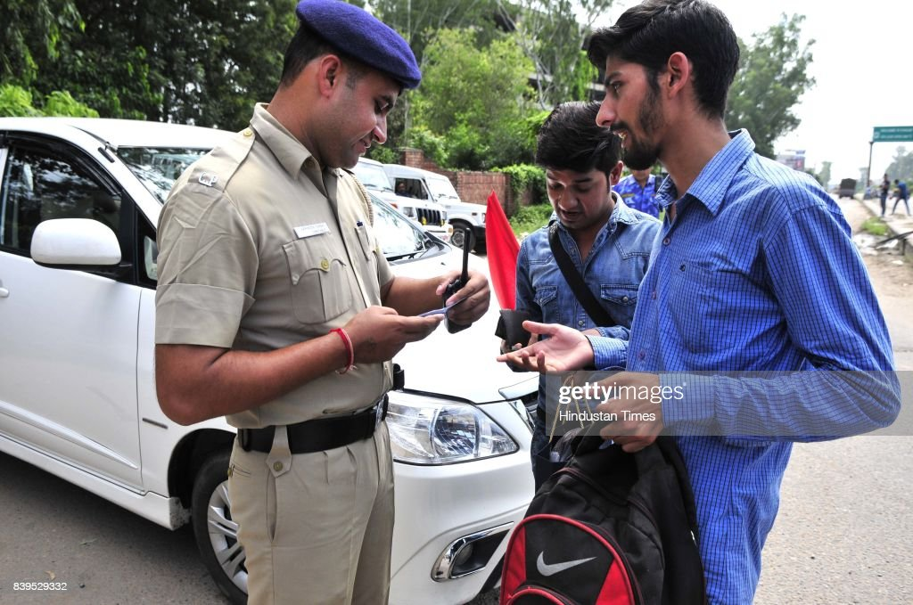 Security personals along with Chandigarh police checking the visitors I card in the entry point of Chandigarh on August 26 2017 in Panchkula India At.