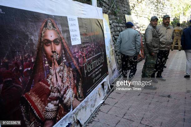 Security personals standing outside the theater on the day of releasing of controversial movie Padmavat to control the any incident on January 25...