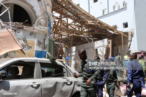 Security personel secure the scene of a carbomb attack on February 4 2019 in Somalia capital Mogadishu's Hamarwayne District At least nine people...