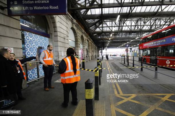 Security personel stand guard outside a police cordon at Waterloo Station central London on March 5 following a report of a suspicious package at the...