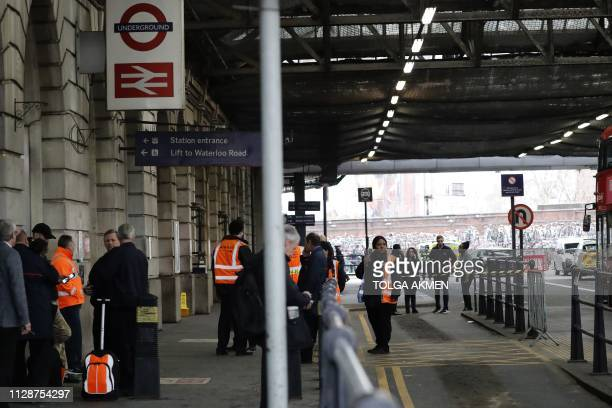 Security personel stand guard outside Waterloo station in central London on March 5 following a report of a suspicious package at the station Three...