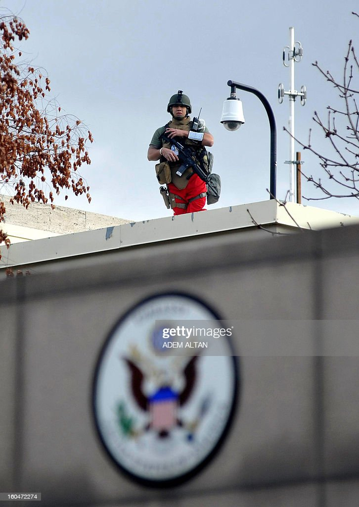 A US security personel stands guard on February 1, 2013 on the roof of one of the compunds inside the US Embassy in Ankara. A Turkish security guard was killed and several other people wounded in a suicide bombing at the entrance to the highly-fortified US embassy in Ankara on February 1, officials said. The force of the blast damaged nearby buildings in the upmarket Cankaya neighbourhood of the capital where many other state institutions and embassies are also located. ALTAN