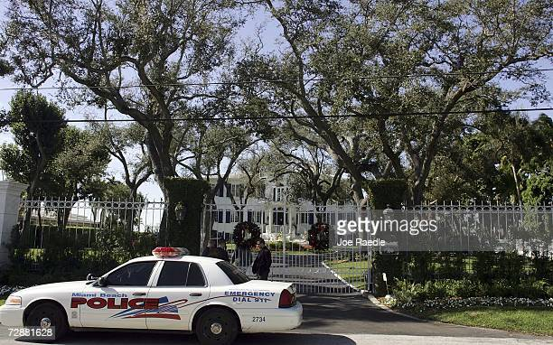 Security personnel and a city of Miami Beach police officer guard the front entrance to the home where British Prime Minister Tony Blair and his...