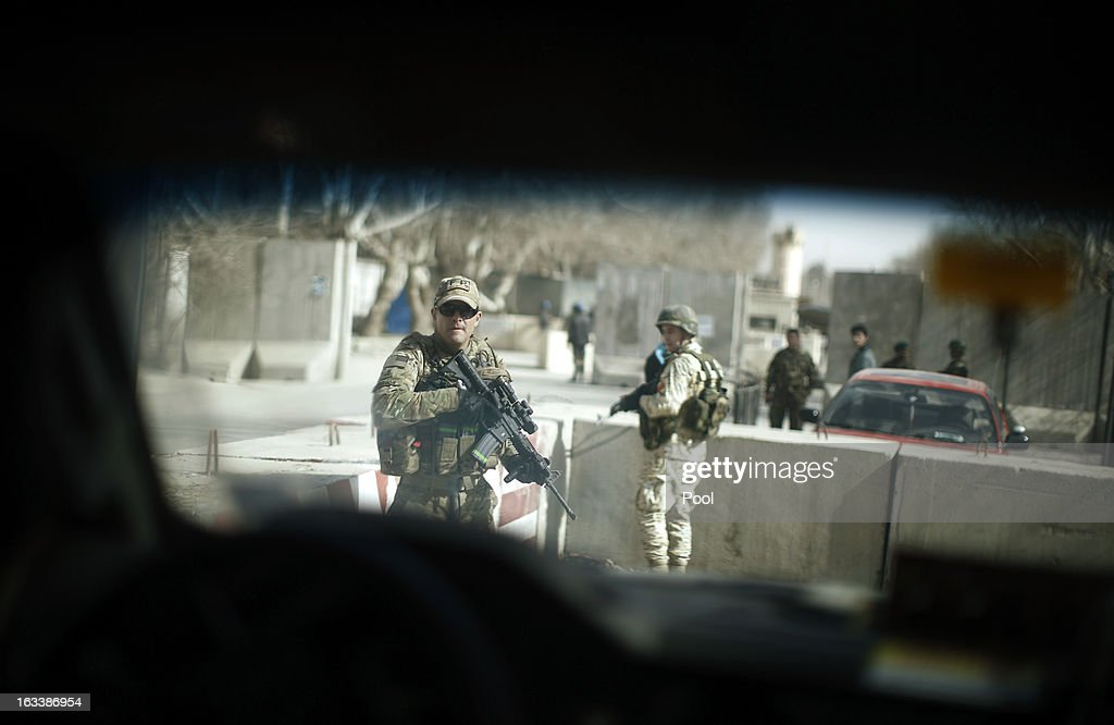 Security personnel are pictured as a media vehicle travelling with U.S. Defense Secretary Chuck Hagel leaves a military compound March 9, 2013 in Kabul, Afghanistan. Shortly before the vehicle movement, a suicide blast hit the Defence Ministry in Kabul. It is Hagel's first official trip since being sworn-in as U.S. President Barack Obama's Defense Secretary.