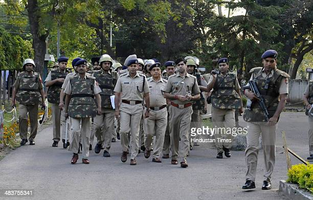 Security personnel at vote at Government Model Senior Secondary School Sec-18 during Lok Sabha Elections on April 10, 2014 in Chandigarh, India. In...