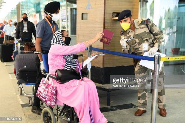 Security personnel check passports of British nationals before checking-in for a special flight bound to London during a government-imposed...