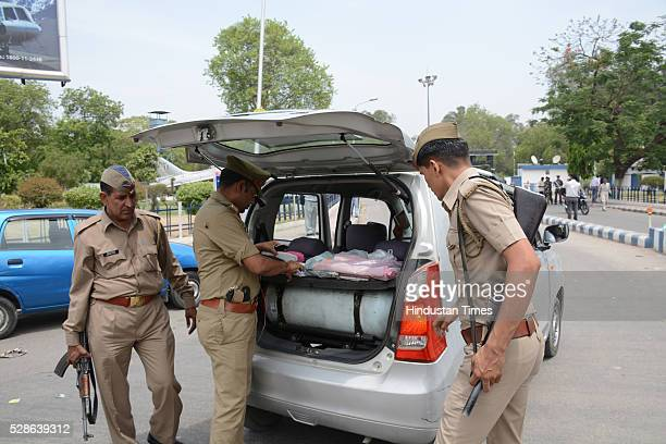 Security personnel check people at gate as joint search operation being carried on by police and Air Force team at Hindon Airbase after a man was...