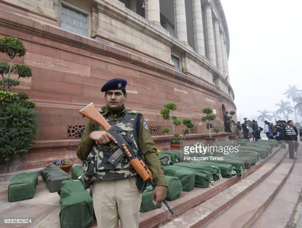 Security personnel checking the budget papers at Parliament House on February 1 2017 in New Delhi India
