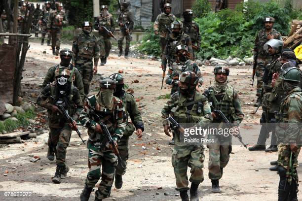 TURKIWANGAM SHOPIAN JAMMU KASHMIR INDIA Security personnel during a cordon and search operation in Shopian Kashmir on Thursday to flush out militants...