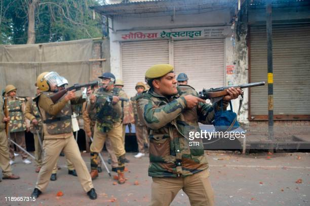 Security personnel fire teargas during demonstrations against India's new citizenship law in Meerut on December 20 2019 Five more protesters died in...