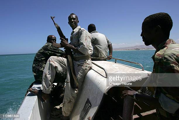 Security personnel from the semiautonomous Somali region of Puntland aboard a Puntland patrol vessel patrol the Gulf of Aden near Bosaso Somalia...
