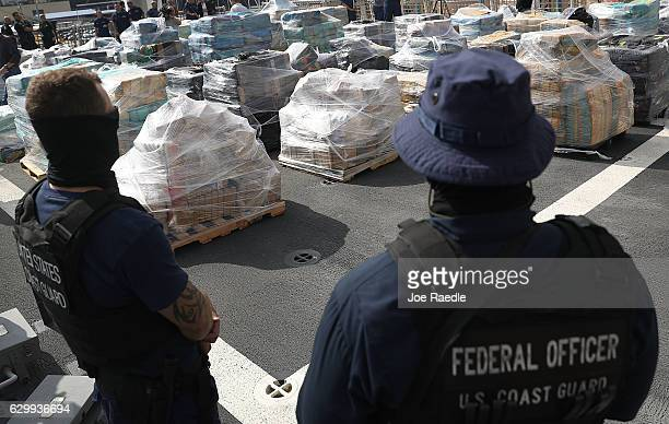Security personnel from the US Coast Guard ship Hamilton guard the approximately 265 tons of cocaine on the deck of the ship at Port Everglades on...
