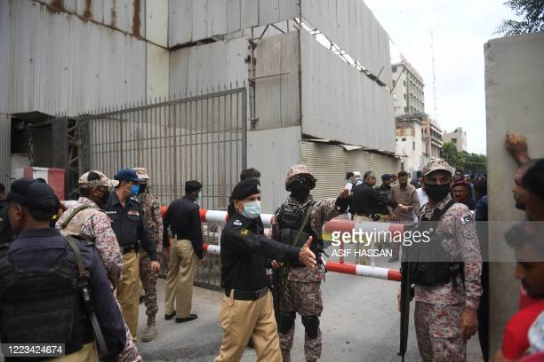 Security personnel gather at the main entrance of the Pakistan Stock Exchange building in Karachi on June 29 2020 Gunmen attacked the Pakistan Stock...
