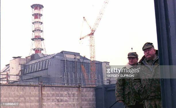 Security personnel guard the entrance of the Chernobyl Nuclear Power Plant near Pripyat Ukraine 24 April as security measures were reinforced in...