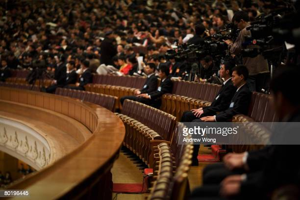 Security personnel guard the fourth plenary session of the National People's Congress or parliament at the Great Hall of the People on March 11 2008...