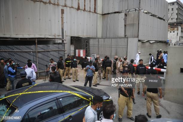 Security personnel guard the main entrance of the Pakistan Stock Exchange building in Karachi on June 29 2020 Gunmen attacked the Pakistan Stock...