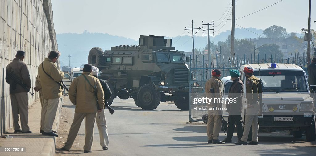 Security personnel guarding the road leading to Pathankot Air Force Station at Dhaki Chowk during an ongoing attack on the base in the northern...