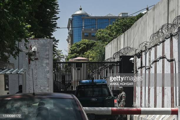 Security personnel guards an entrance near the Australian embassy at the Green Zone in Kabul on May 25 after Australia abruptly announced to shutter...