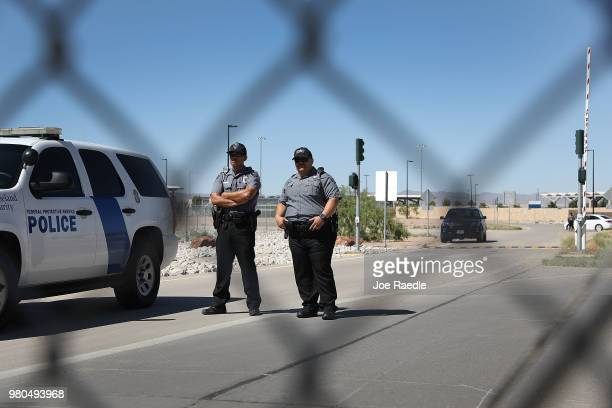 Security personnel keep an eye on the mayors and media at the Tornillo-Guadalupe Port of Entry on June 21, 2018 in Fabens, Texas. Mayors from the...