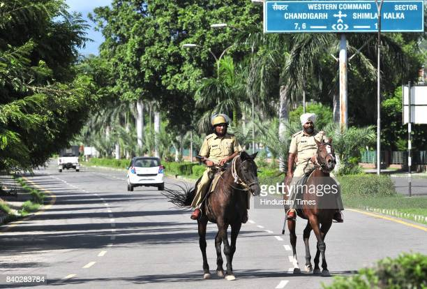 Security personnel march during pronouncement of the sentence against the Dera Sacha Sauda cult chief Gurmeet Ram Rahim Singh in dual rape case on...