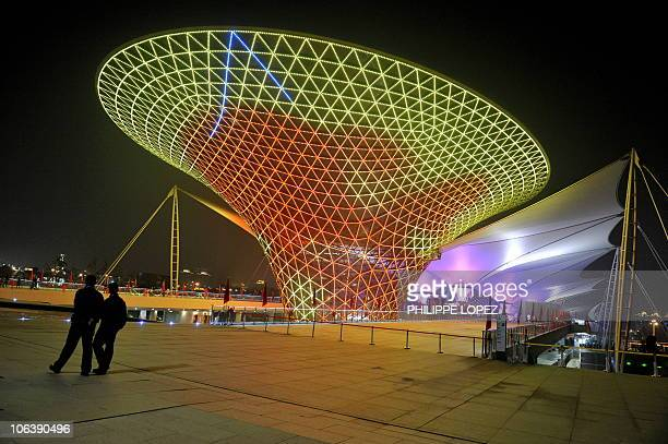 Security personnel members walk past an illuminated structure of the Expo boulevard at the site of the World Expo 2010 in Shanghai on October 31 2010...
