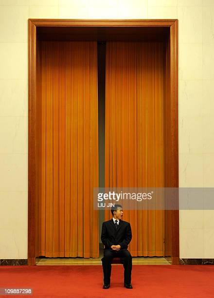 A security personnel monitors the situation on the sidelines of National People's Congress at the Great Hall of the People in Beijing on March 8 2011...