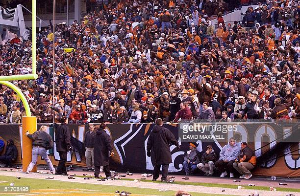 Security personnel move in front of the Dawg Pound fan section at Cleveland Browns Stadium in Clevelnd Ohio as fans begin to throw beer bottles and...