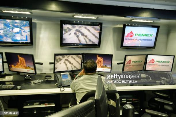 Security personnel of stateowned oil giant PEMEX monitors the screens from the operations and surveillance center to prevent fuel theft in Puebla...