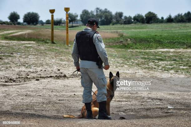 Security personnel of stateowned oil giant PEMEX patrol a clandestine fuel siphoning area in Tepeaca Puebla State Mexico on May 26 2017 Violent...
