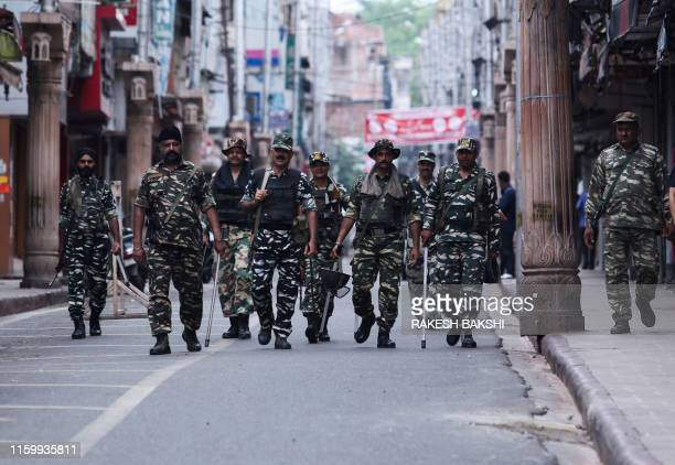 Security personnel patrol along a street in Jammu on August 6 2019 Washington on August 4 urged respect for rights and called for the maintenance of...